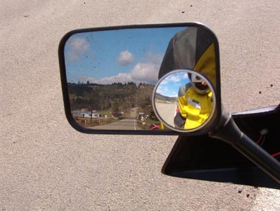 Geography typical of the area, view though the motorcycle mirror