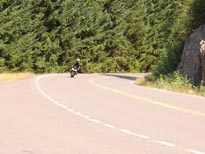 My riding partner doing the sweeper bits along the south end
